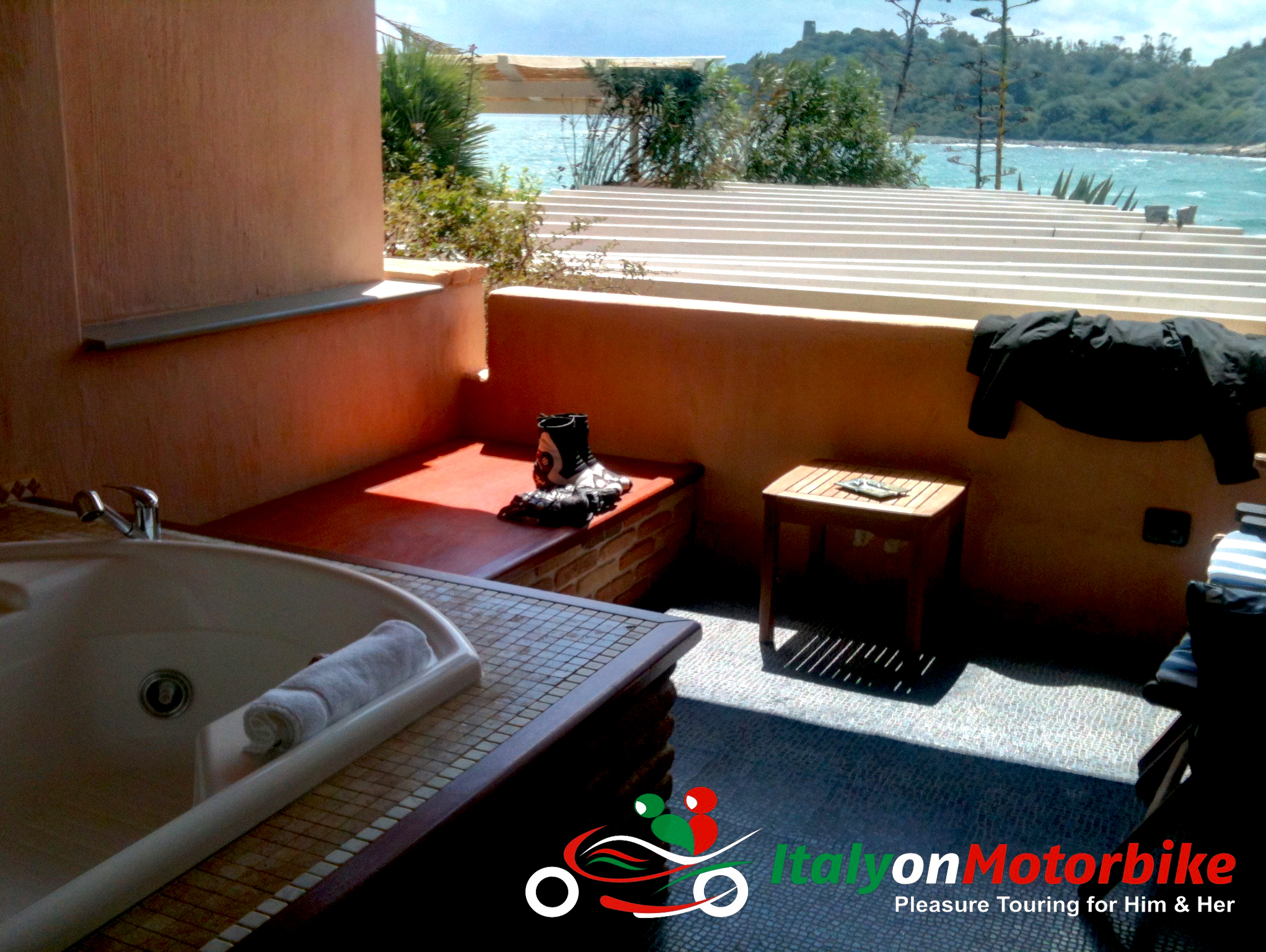 An open air private bathroom with a view on one of our motorcycle trip in Italy