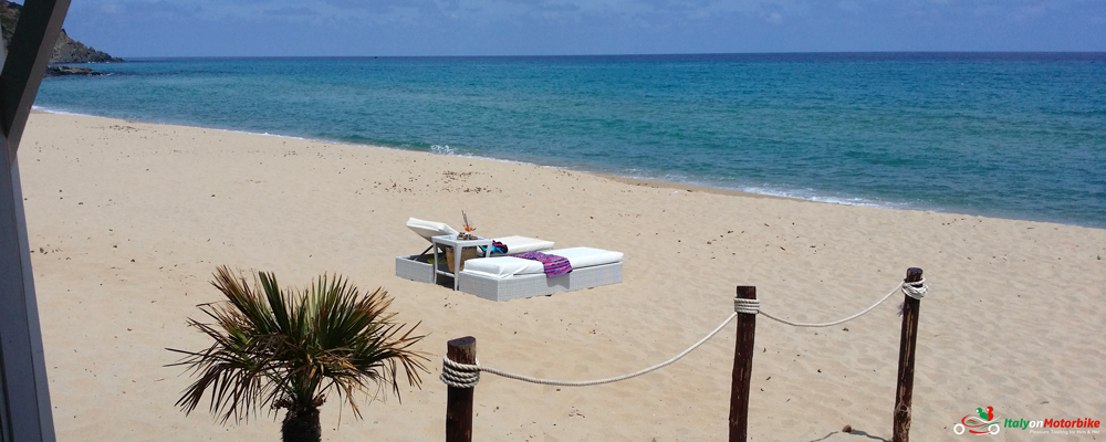 Sunbeds on a beautiful beach, an option for a holiday extension after one of our motorcycle tour in Italy