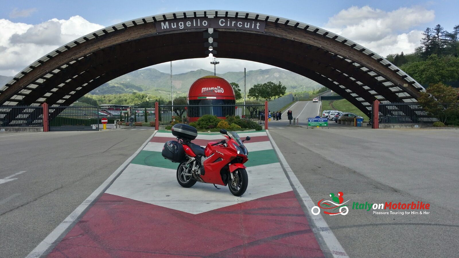 A Honda VFR800 in front of the gates of the racing track of Mugello on one of our guided motorcycle tour in Italy