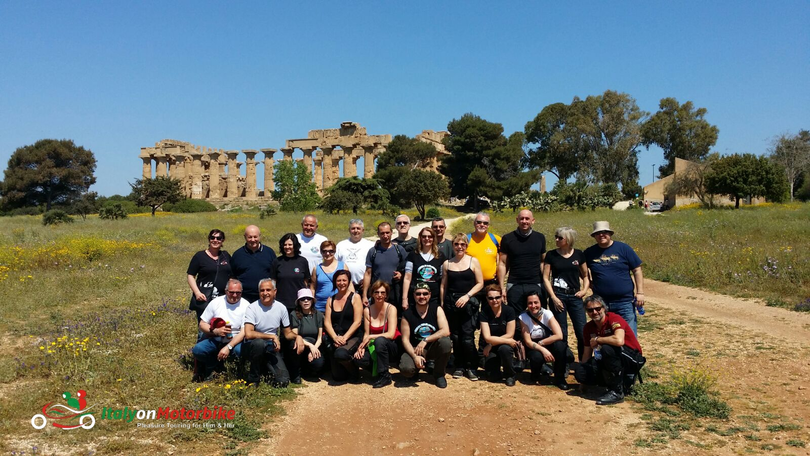A groupe of bikers in front of a Roman temple on one of our motorcycle tour in Italy