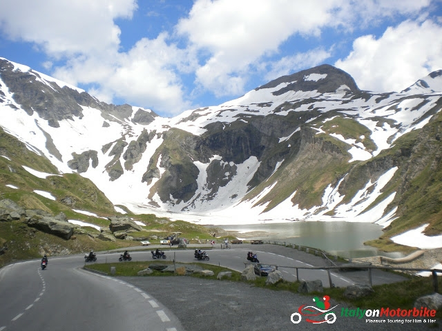 Bikers enjoying a hairpin in the Alps on one of our motorcycle tour in the Alps