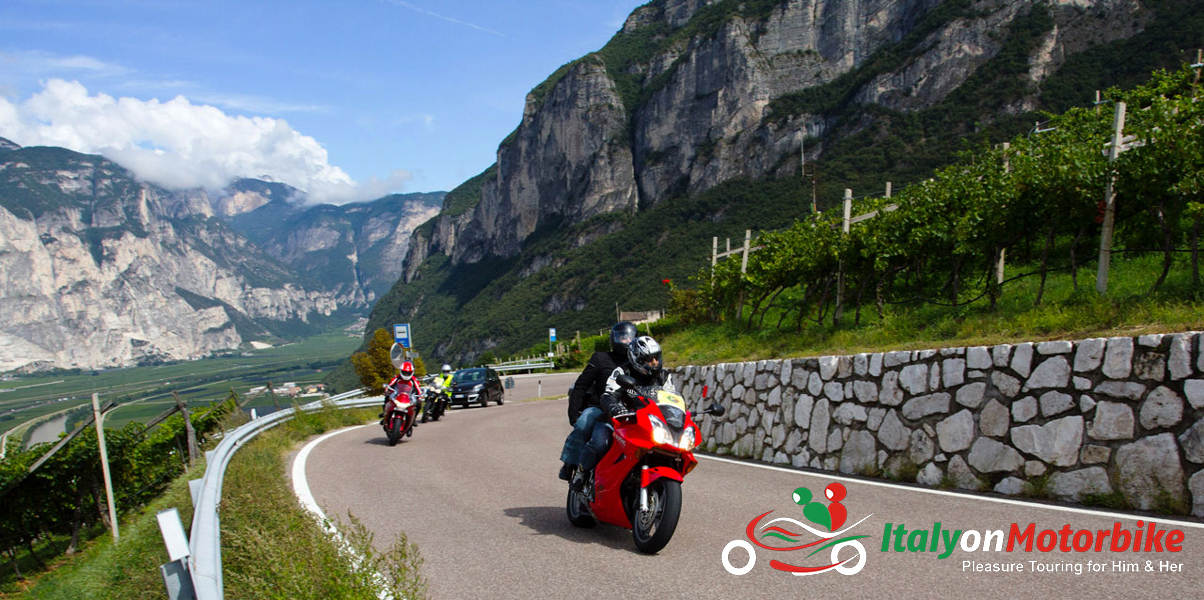 A group of riders on enjoying the best biking roads in Trento on one of our motorcycle tour in Italy