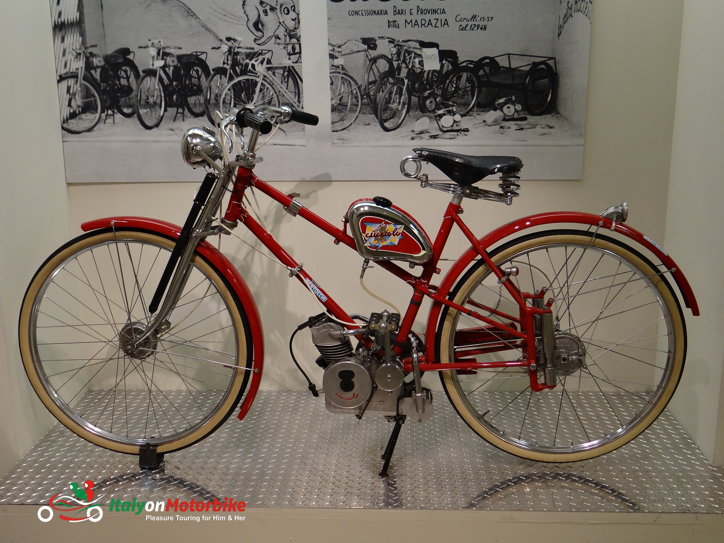 A Ducati Cucciolo at the Ducati museum available to see on our Top Class motorcycle tour of Italy with a MotoGP